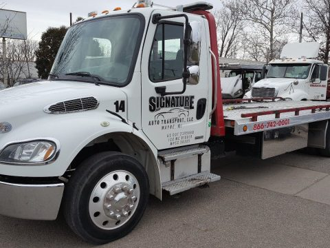 good condition 2011 Freightliner 2 Car Flatbed tow truck for sale