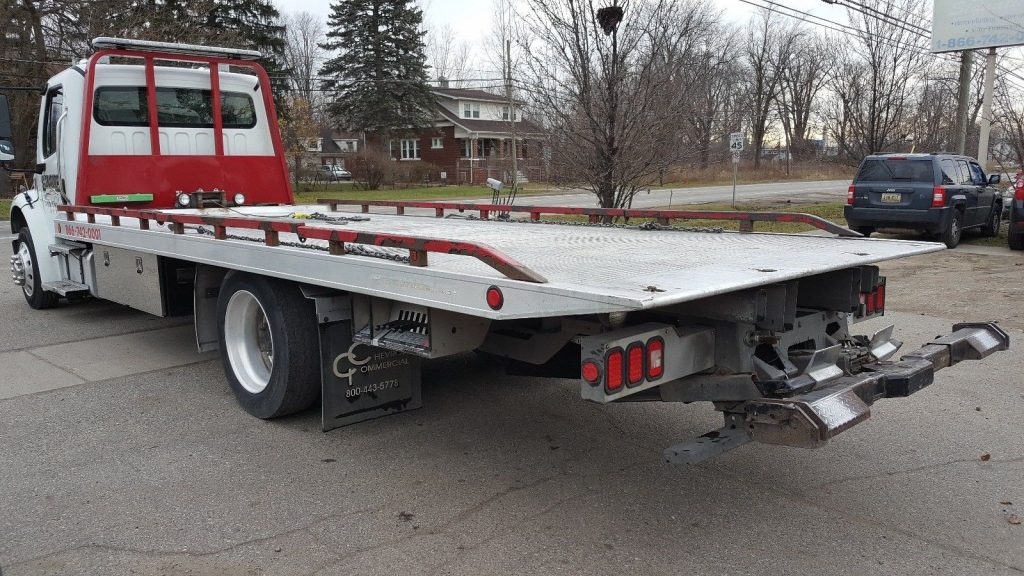 good condition 2011 Freightliner 2 Car Flatbed tow truck