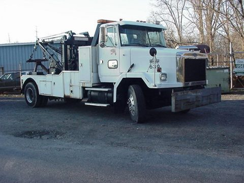 low miles 1990 Autocar HOLMES wrecker truck for sale