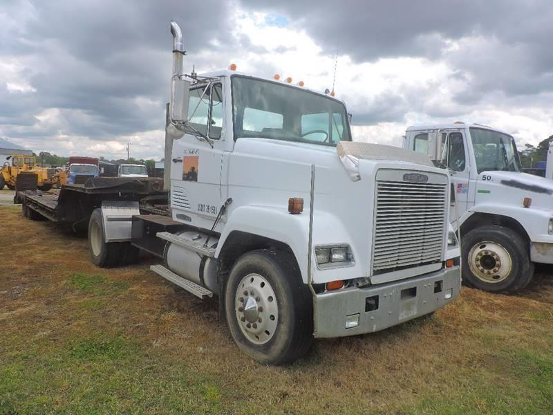 solid 1990 Freightliner Road Tractor Day Cab truck