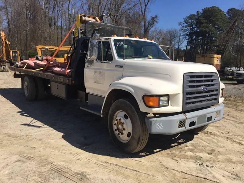 solid 1997 Ford F Series Rollback truck