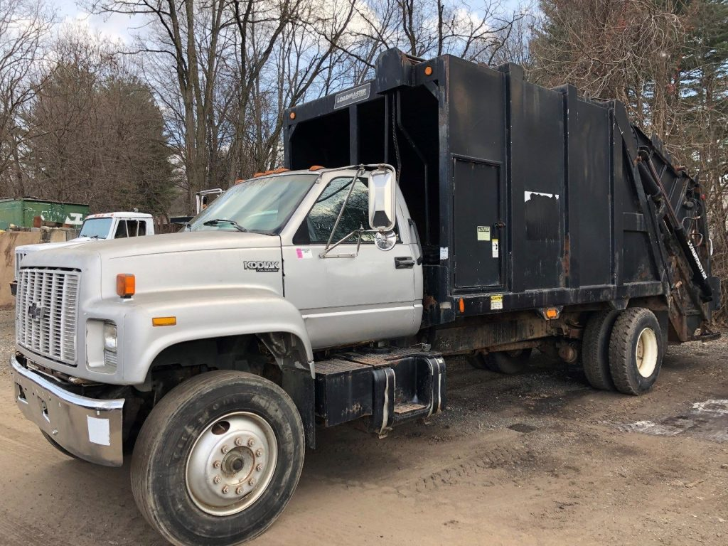 strong and solid 1994 Chevrolet C7500 Garbage Truck