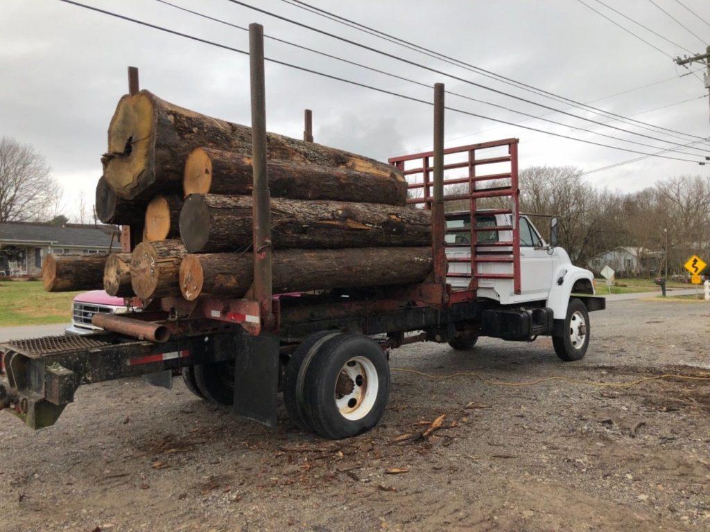 super clean 1994 Ford F750 4×4 log truck